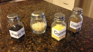 Use salt and grated cheese shakers for seeds and corn meal.